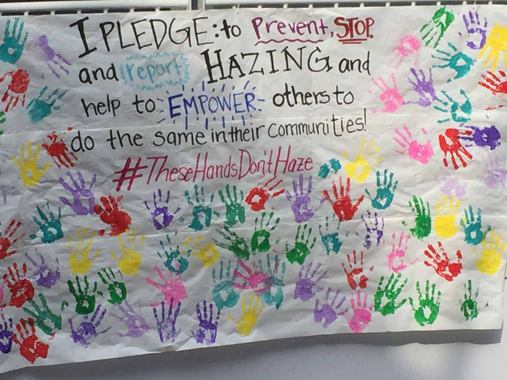 Poster with pledge to prevent, stop and report hazing